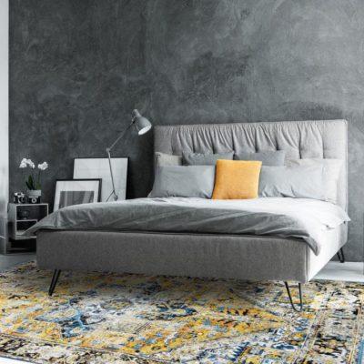 Monochromatic bedroom with mirror